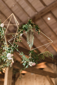Emma Lea Floral- Purple Summer Events- Kristen Pierson Photography- Devils Thumb Ranch Colorado Wedding    Head Table   Hanging Geometric Shapes with Greenery and Floral Detail  