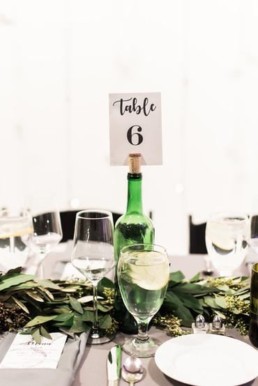 Emma Lea Floral - Purple Summer Events- Kristen Pierson Photography- Space Gallery Denver Colorado Wedding | Wine Bottle Table Number | Greenery Garland | Wine Themed Wedding | Eucalyptus |