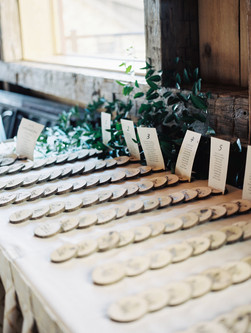 Emma Lea Floral- Purple Summer Events- Kristen Pierson Photography- Devils Thumb Ranch Colorado Wedding  | Escort Card Table | Greenery | Wood Slices |