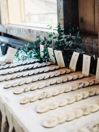 Emma Lea Floral- Purple Summer Events- Kristen Pierson Photography- Devils Thumb Ranch Colorado Wedding    Escort Card Table   Greenery   Wood Slices  