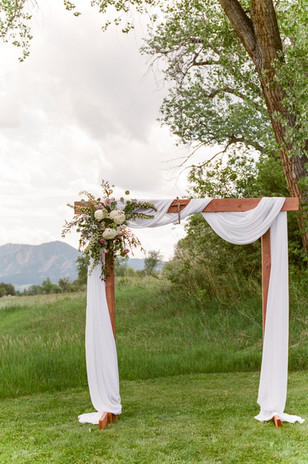 Emma Lea Floral- Purple Summer Events- Lisa O'dwyer Photography- Boulder Private Estate Colorado Wedding  | Ceremony Draping| Arch Flowers | White and Lavender | Eucalyptus |