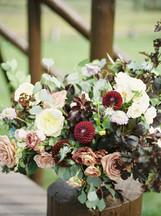Emma Lea Floral- The Styled Soiree- Sara Lynn Photography- Devils Thumb Ranch Colorado Wedding  | Ceremony Floral Arrangement | Burgundy, Blush, Ivory, Blue | Garden Rose | Dahlia | Mountain Wedding |