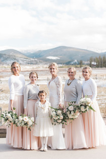 Emma Lea Floral- Purple Summer Events- Kristen Pierson Photography- Devils Thumb Ranch Colorado Wedding    Bridal Party   Bridesmaids   Flower Girl   Pink Skirts   White Sweaters   White Flowers and Greenery Bouquets   Mountain Wedding  