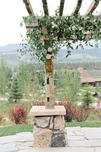 Emma Lea Floral- Purple Summer Events- Callie Hobbs Photography- Devils Thumb Ranch Colorado Wedding  | Ceremony Pergola Flowers | Greenery | White Flowers | Roses | Spray Roses |
