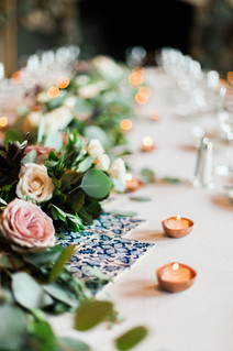Emma Lea Floral- The Styled Soiree- Sara Lynn Photography- Devils Thumb Ranch Colorado Wedding  | Greenery and Floral Garland | Portuguese Blue Tile | Copper Tealights | Head Table | Mountain Wedding |