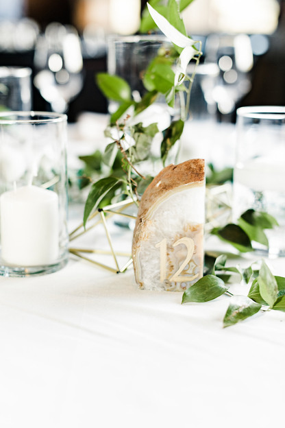 Emma Lea Floral- Purple Summer Events- Kristen Pierson Photography- Devils Thumb Ranch Colorado Wedding   Candles In Glass Centerpiece   Smilax Greenery   Geode Table Number   Geometric Details  