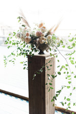 Emma Lea Floral- Purple Summer Events- Kristen Pierson Photography- Devils Thumb Ranch Colorado Wedding    Ceremony Floral Arrangement   Pampas Grass   Garden Rose   Smilax   Rustic Stand   Mountain Wedding  