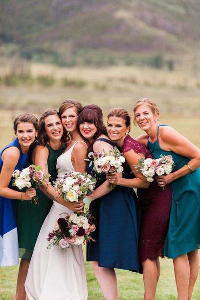 Emma Lea Floral- The Styled Soiree- Sara Lynn Photography- Devils Thumb Ranch Colorado Wedding  | Bridal Party | Jewel Tone Bridesmaid Dresses | Bouquets | Mountain Wedding |