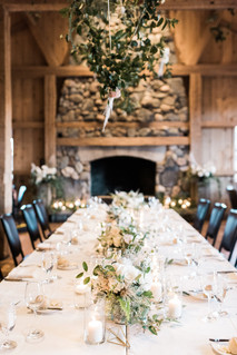 Emma Lea Floral- Purple Summer Events- Kristen Pierson Photography- Devils Thumb Ranch Colorado Wedding    Candles In Glass Centerpiece   Smilax Greenery   Geode Table Number   Geometric Details   Head Table   Hanging Geometric Shapes With Greenery and Floral Detail  