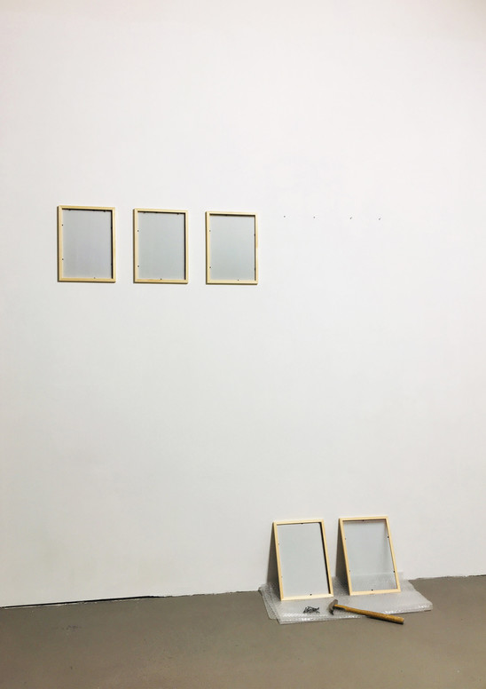 hanging frames on the wall