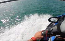 Close up of someone driving a jetski 230