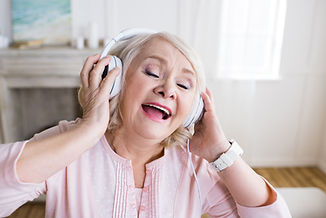 happy-senior-woman-with-closed-eyes-wear