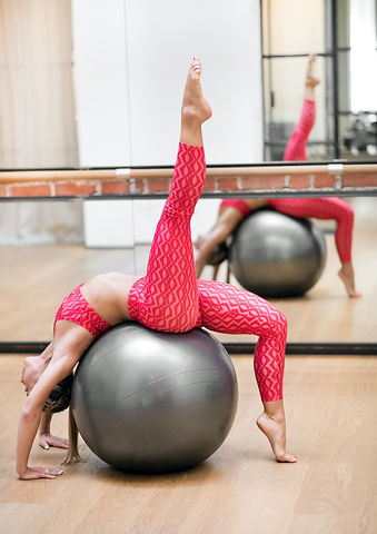 woman-exercising-on-a-stability-ball-in-