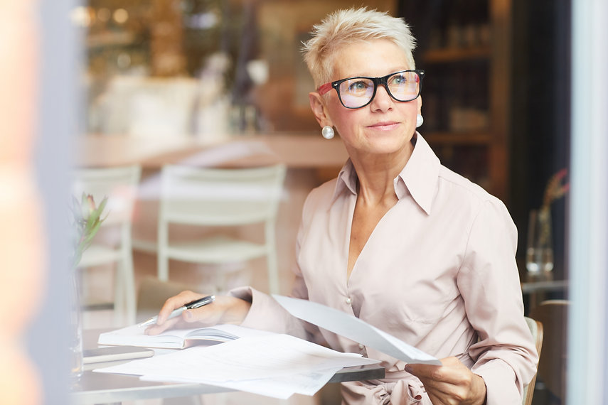 mature-woman-working-with-documents-RAR2