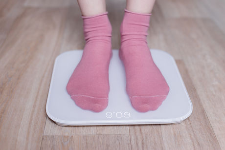 woman-measuring-her-weight-on-a-modern-s