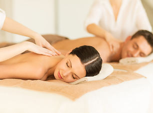 picture of couple in spa salon getting m