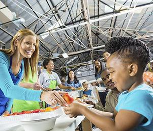 Volunteers Serving Food