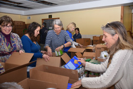 Many hands, fun work- Vacation box pack with volunteers from MUCH, Keene Community Kitchen and KECR