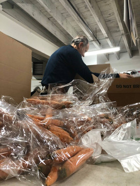 Food box packs Keene Community Kitchen- over 100 boxes in under an hour- KECR, MUCH, KCK