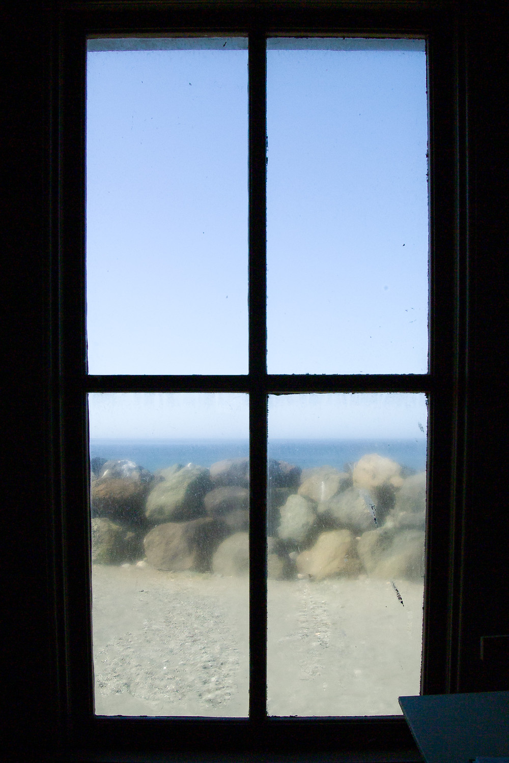 Photo of view out dirty lighthouse window