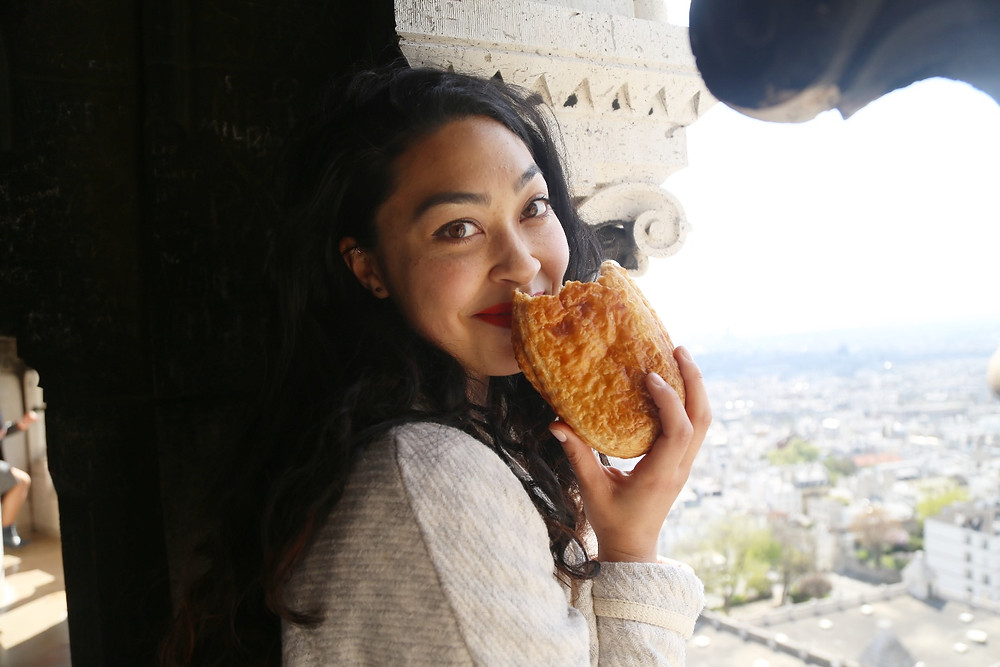 Croissant eater at Sacre Coeur