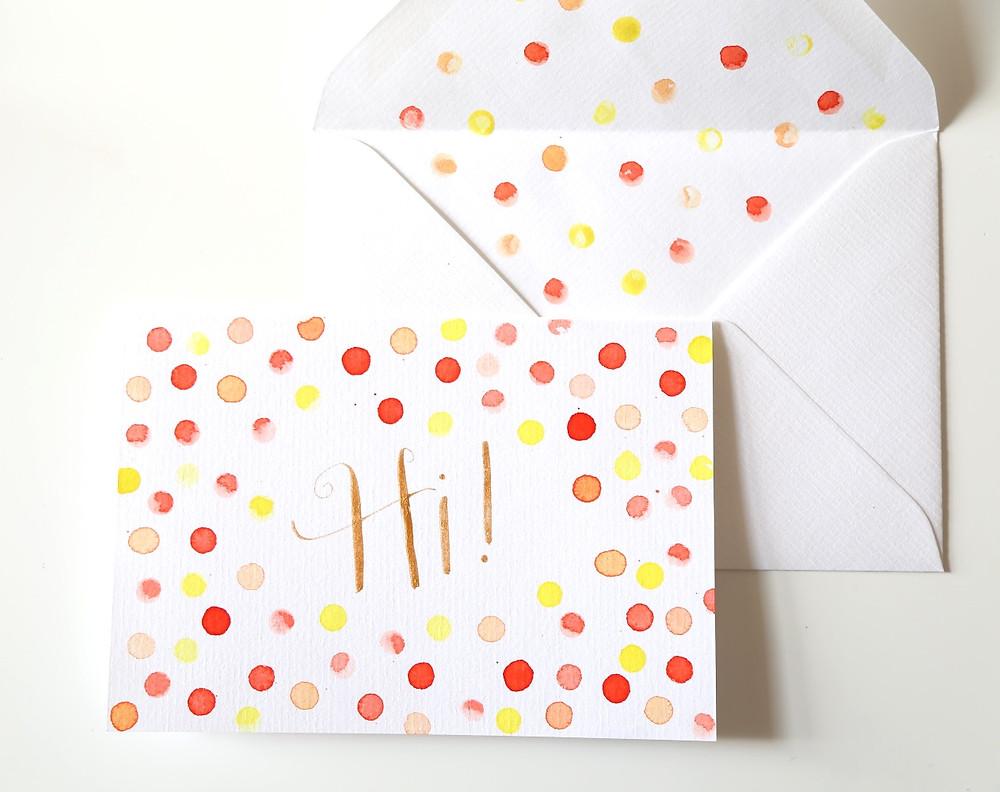 polka dots and gold calligraphy