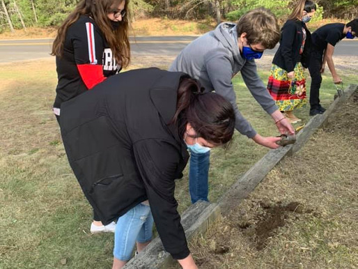 LCO School plants Red Honor Garden for Murdered and Missing Women