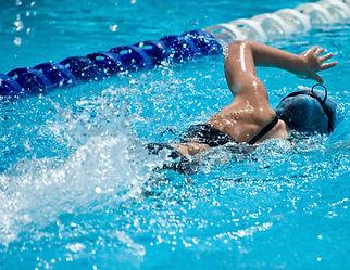 woman swimming triathlon
