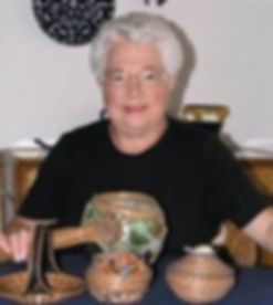 Kathy Erickson with some of her beautiful baskets._edited_edited.jpg