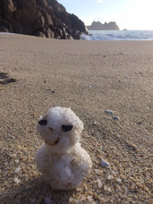 Snowy figure on Porthcurno beach