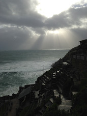 Sun breaking through from the Minack Theatre