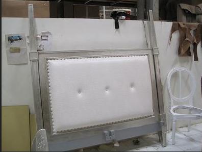 Custom silver leaf upholstered bed