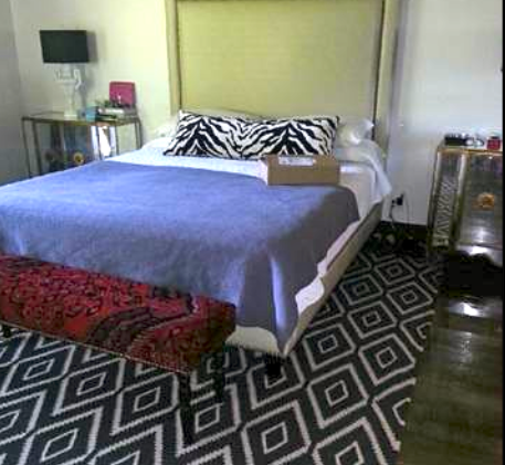 Custom oversized upholstered bed for a Memphis project