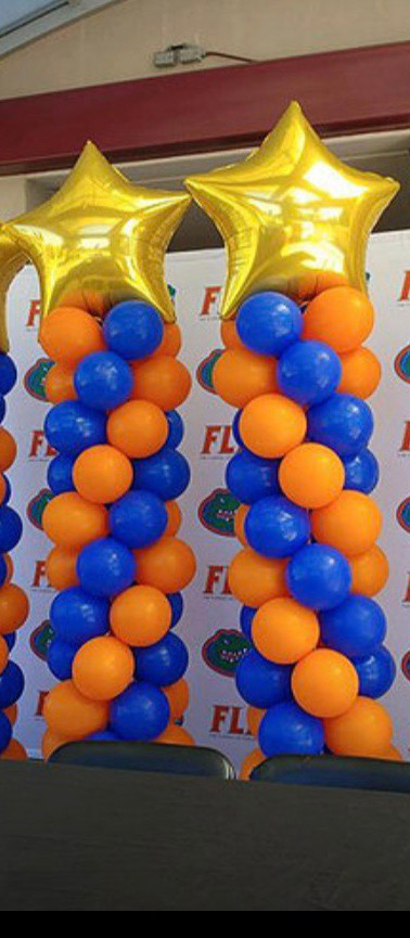 ORANGE AND BLUE SWIRL COLUMNS W/STAR TOPPER