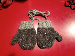 Knitted grey and green baby mittens