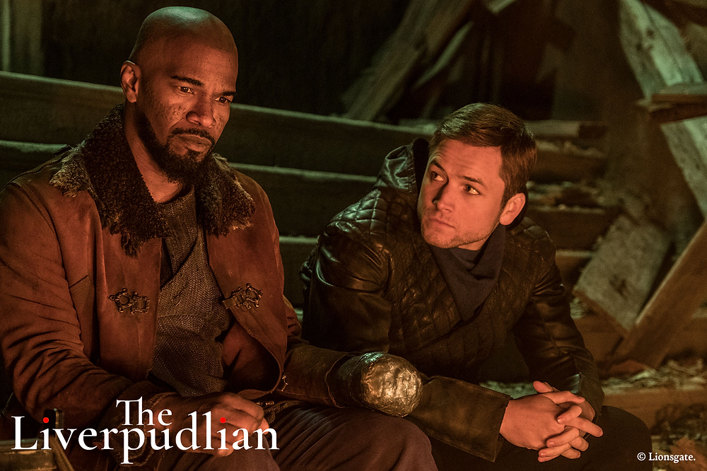 Taron Egerton and Jamie Foxx starring in the 2018 blockbuster film, Robin Hood (Credit: Lionsgate).