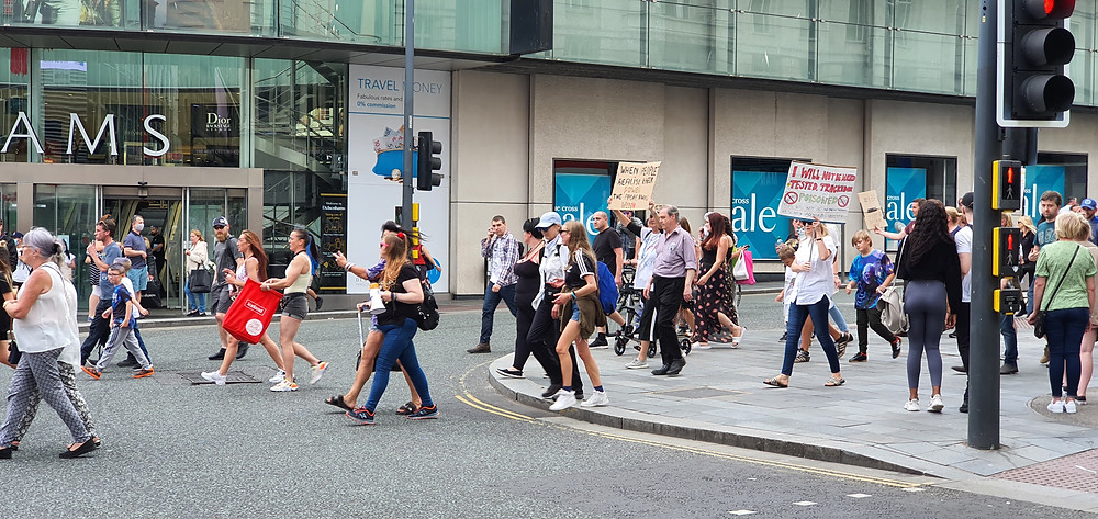 'Anti-Mask' protesters in Liverpool City Centre around 4:10pm walking down Lord Street in Liverpool One shouting abuse at pedestrians for wearing masks (Credit: Peter Eric Lang).