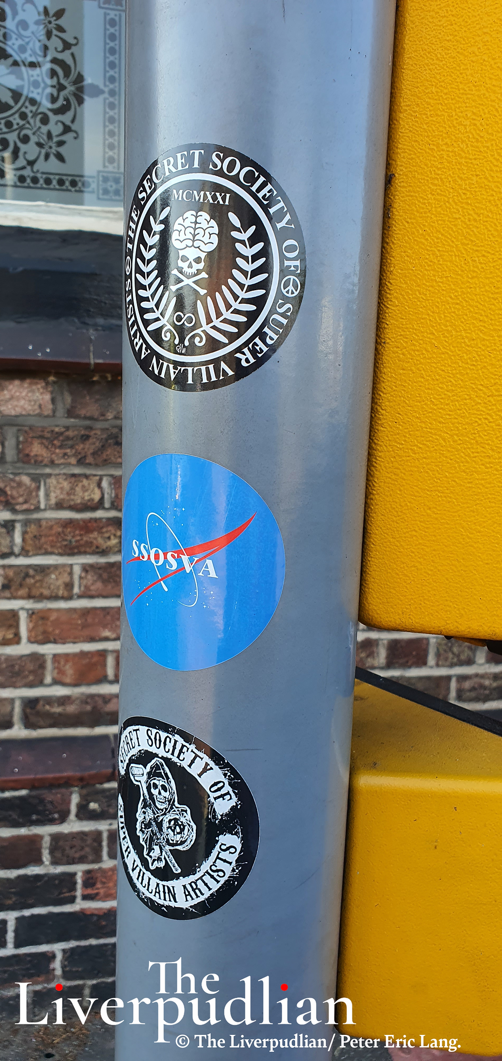 SSOSVA stickers on the traffic lights outside of the Halfway House pub (Credit: The Liverpudlian/Peter Eric Lang).