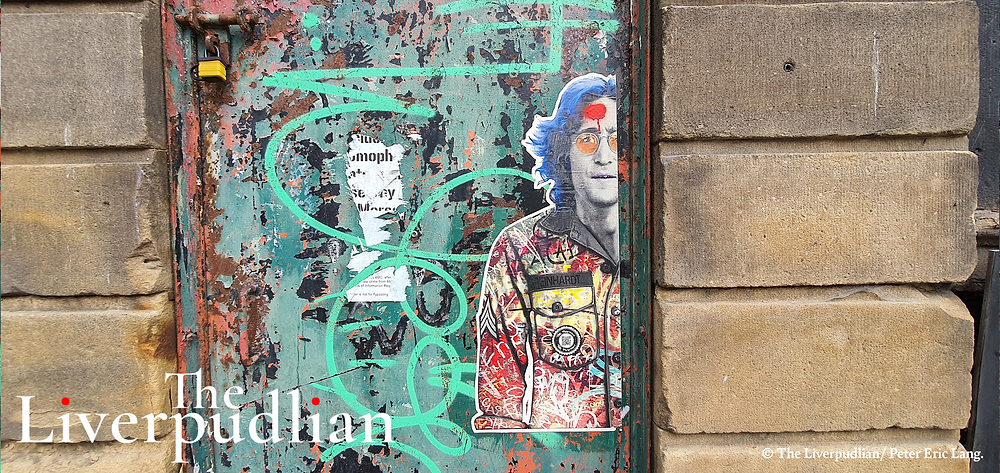 John Lennon paste up artwork, located at Hackins Hey in Liverpool's The Commercial District by 'The Postman', a collective of pop-culture artists from Brighton (Credit: Peter Eric Lang).