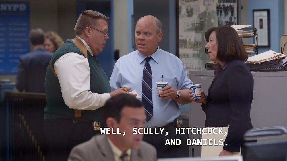 Scully, Hitchcock and Daniels chatting in the 99th Precinct, right before she disappeared for good! (Credit: NBC).