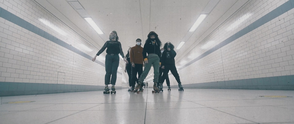 An advertisement for the Invisible Wind Factory in which roller-skaters are making their way to the venue on the City's underground train system (Credit: Image supplied by Invisible Wind Factory).