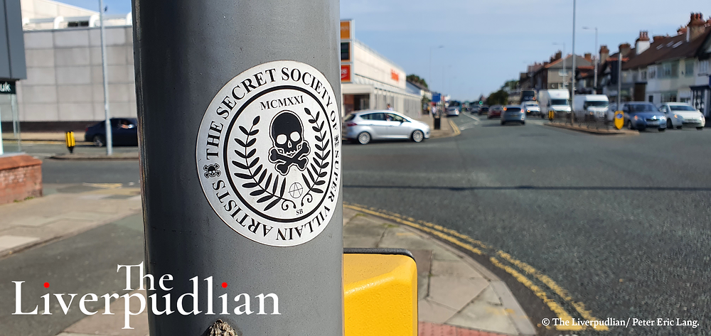 'Secret Society of Super Villain Artists' sticker at the junction outside the Prenton YMCA (Credit: The Liverpudlian/Peter Eric Lang).