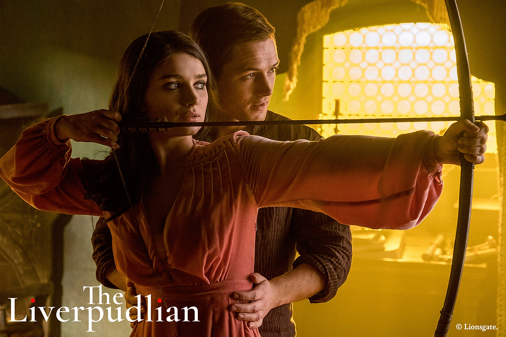 Taron Egerton as Robin Hood with Eve Hewson as Lady Marian (Credit: Lionsgate).