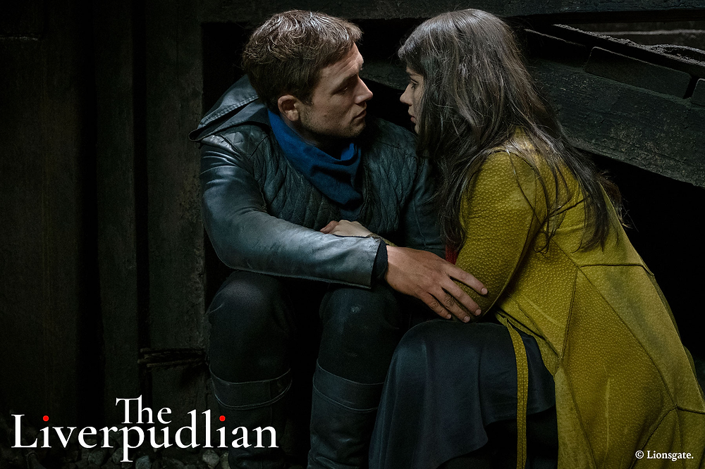 Taron Egerton and Eve Hewson starring in the 2018 blockbuster film, Robin Hood (Credit: Lionsgate).