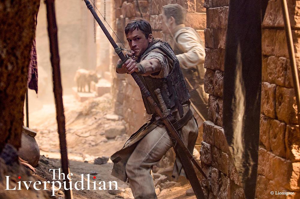 The Liverpudlian-Welshman, Taron Egerton, starring in the 2018 blockbuster film, Robin Hood (Credit: Lionsgate).