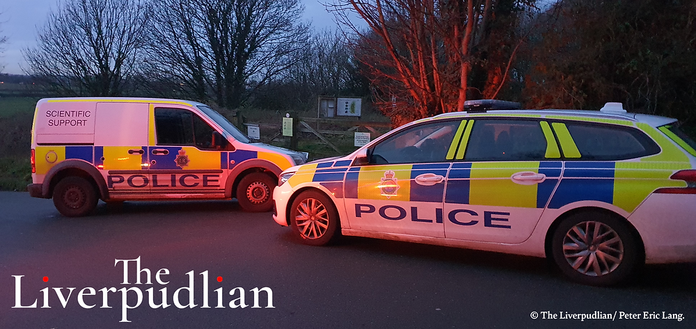 A Police car and a Police Scientific Support van parked on Rest Hill Road in the Storeton Woods Area (Credit: The Liverpudlian/Peter Eric Lang).
