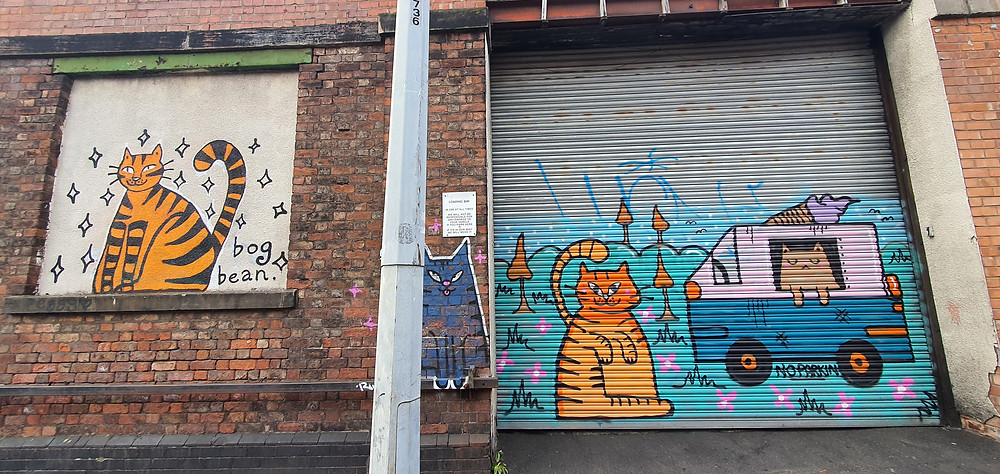 Bold and vivid street art by 'Bean Bog' in Liverpool's The Baltic Triangle depicting cat's running an ice cream van (Credit: The Liverpudlian/Peter Eric Lang).