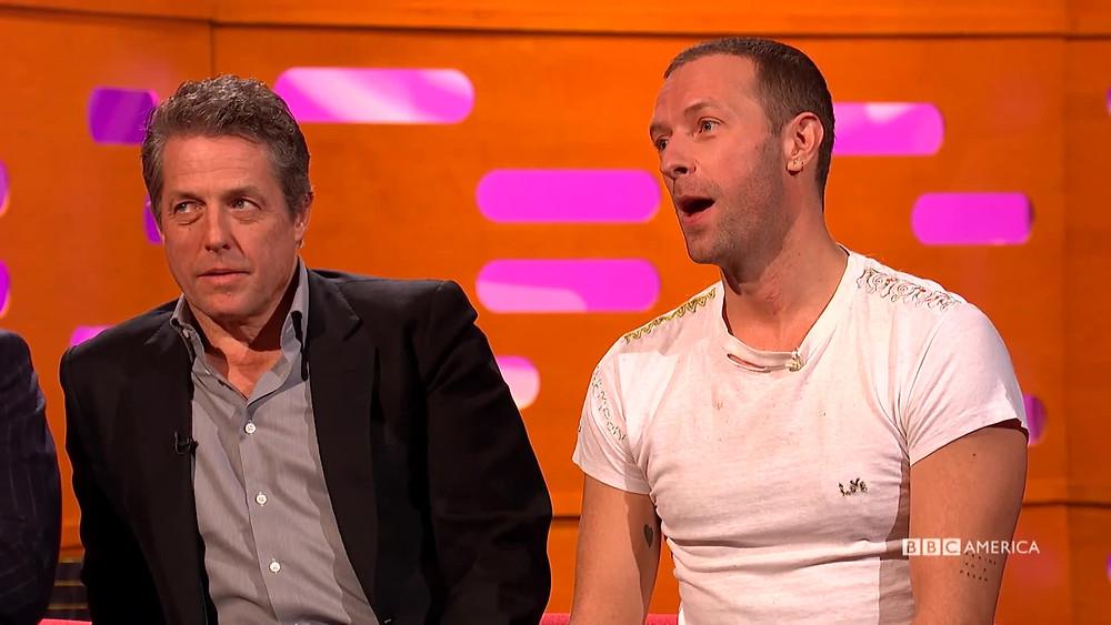 Chris Martin on The Graham Norton Show alongside Hugh Grant (Credit: BBC).