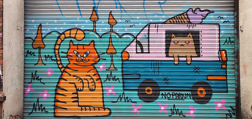 Street art by 'Bean Bog' in Liverpool's The Baltic Triangle depicting cat's running an ice cream van (Credit: The Liverpudlian/Peter Eric Lang).