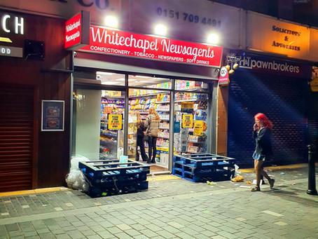 The New York City of Europe Enjoying The Night Time Glow Of Corner Shops Illuminating The Streets